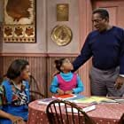 Bill Cosby, Tempestt Bledsoe, and Keshia Knight Pulliam in The Cosby Show (1984)