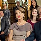 Wendie Malick, Barry Flatman, Jim Thorburn, and Julia Benson in Marrying Father Christmas (2018)