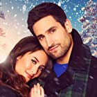 Kaitlyn Leeb and Scott Cavalheiro in Christmas with a View (2018)