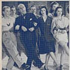 Dorothy Babb, Charles Butterworth, Roland Dupree, Joe Geil, Jane McNab, Jean McNab, Dolores Mitchell, Tommy Rall, Robert Scheerer, and The Jivin' Jacks and Jills in Give Out, Sisters (1942)