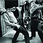 John Cassavetes and Robert Taylor in Saddle the Wind (1958)