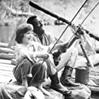 Elijah Wood and Courtney B. Vance in The Adventures of Huck Finn (1993)