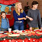 Emily Osment, Jacob Buster, and Trinity Roberts in Christmas Wonderland (2018)