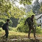 John Krasinski and Noah Jupe in A Quiet Place (2018)