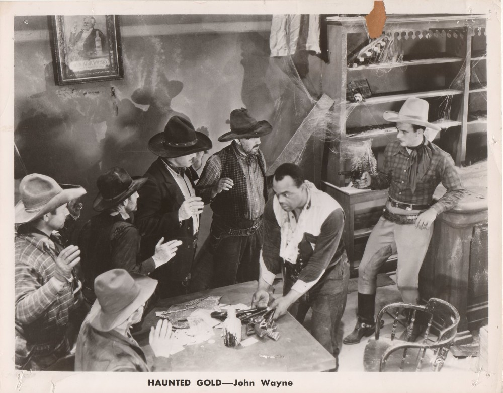 John Wayne, Tom Bay, Ben Corbett, Jim Corey, Blue Washington, and Harry Woods in Haunted Gold (1932)