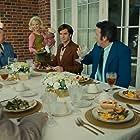 Jim Bakker, Tammy Faye Bakker, Jessica Chastain, and Andrew Garfield in The Eyes of Tammy Faye (2021)
