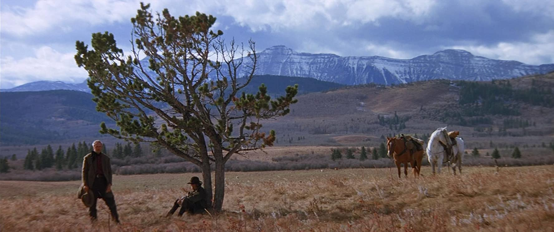 Clint Eastwood and Jaimz Woolvett in Unforgiven (1992)