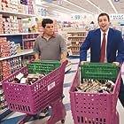 Adam Sandler and Luis Guzmán in Punch-Drunk Love (2002)