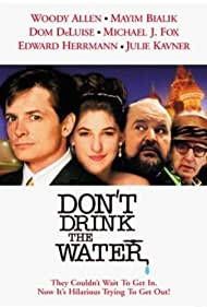 Woody Allen, Michael J. Fox, Dom DeLuise, and Mayim Bialik in Don't Drink the Water (1994)