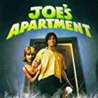 Jerry O'Connell and Megan Ward in Joe's Apartment (1996)
