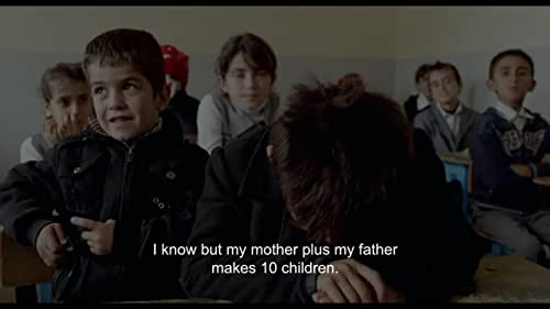 After the fall of Saddam Hussein, Baran, a Kurdish independence war hero, resolves to accept a position in a godforsaken village at the borders of Iran and Turkey, an illegal trafficking Mecca. There he meets Govend, a beautiful young woman who has come to work as the teacher in the newly-opened school despite her twelve brothers' hostility to the idea.