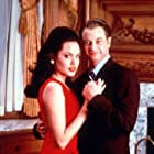 Gary Sinise and Angelina Jolie in George Wallace (1997)