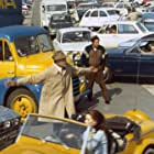 Jacques Tati, Maria Kimberly, and Marcel Fraval in Trafic (1971)