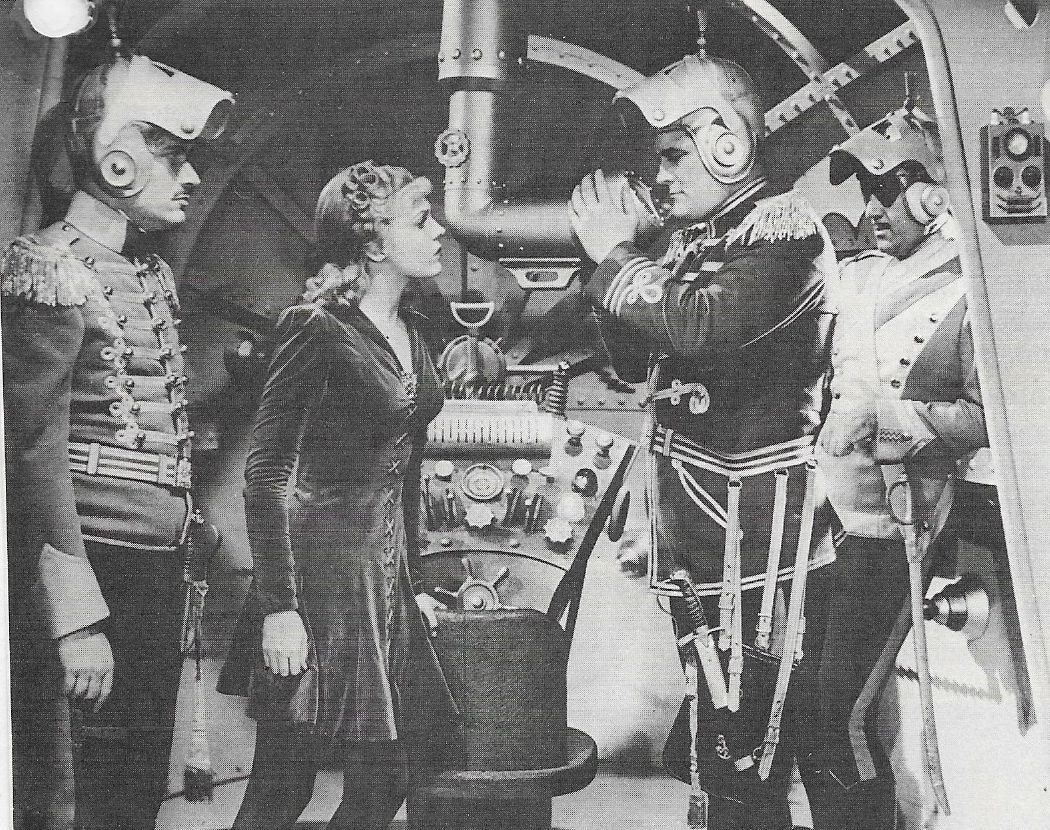 Roy Barcroft, Roland Drew, Anne Gwynne, and Don Rowan in Flash Gordon Conquers the Universe (1940)
