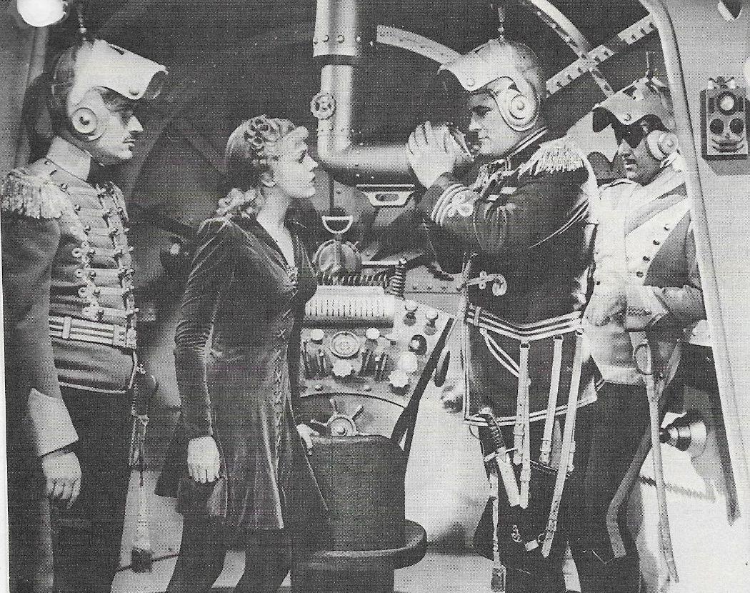 Roy Barcroft, Roland Drew, Anne Gwynne, and Don Rowan in Flash Gordon Conquers the Universe (1940)