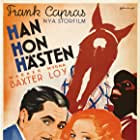 Myrna Loy, Warner Baxter, Clarence Muse, and Broadway Bill in Broadway Bill (1934)