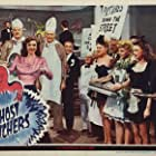 Ramsay Ames, Billy Curtis, Morton Downey, Chic Johnson, Ella Mae Morse, Jack Norton, Martha O'Driscoll, and Ole Olsen in Ghost Catchers (1944)