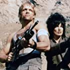 Kathy Shower and Brian Thompson in Commando Squad (1987)