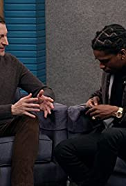 A$AP Rocky Wears a Black Button Up Jacket and Black Sneakers Poster