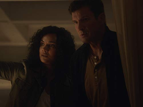 Nathan Fillion and Mekia Cox in The Overnight (2020)