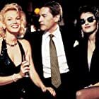 Helmut Berger, Brigitte Lahaie, and Florence Guérin in Faceless (1987)