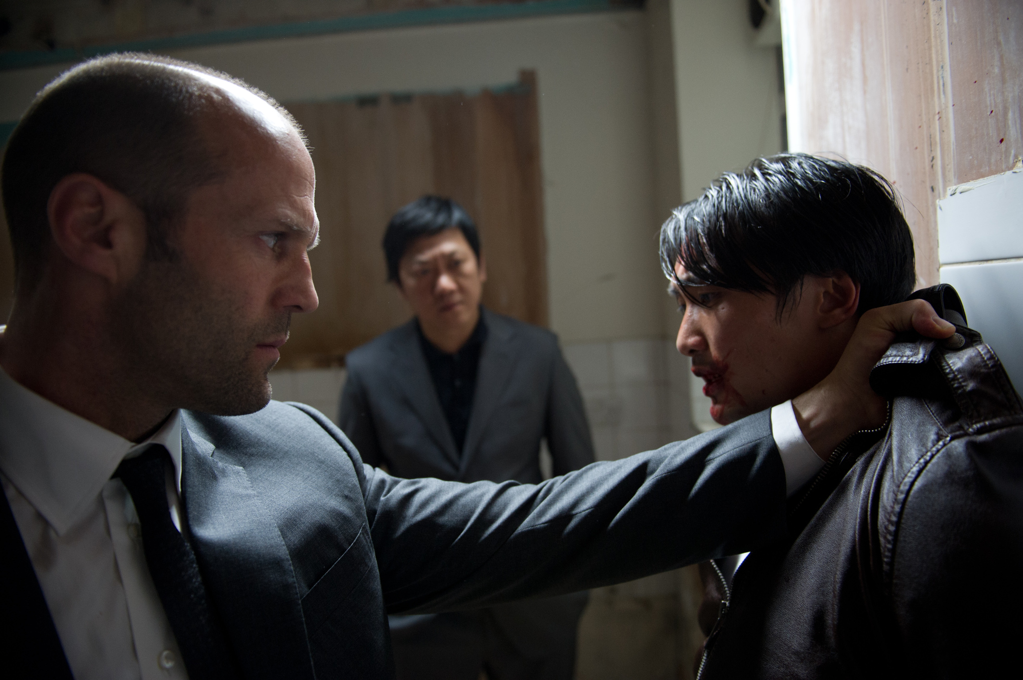 Jason Statham, Benedict Wong, and Aaron Ly in Hummingbird (2013)