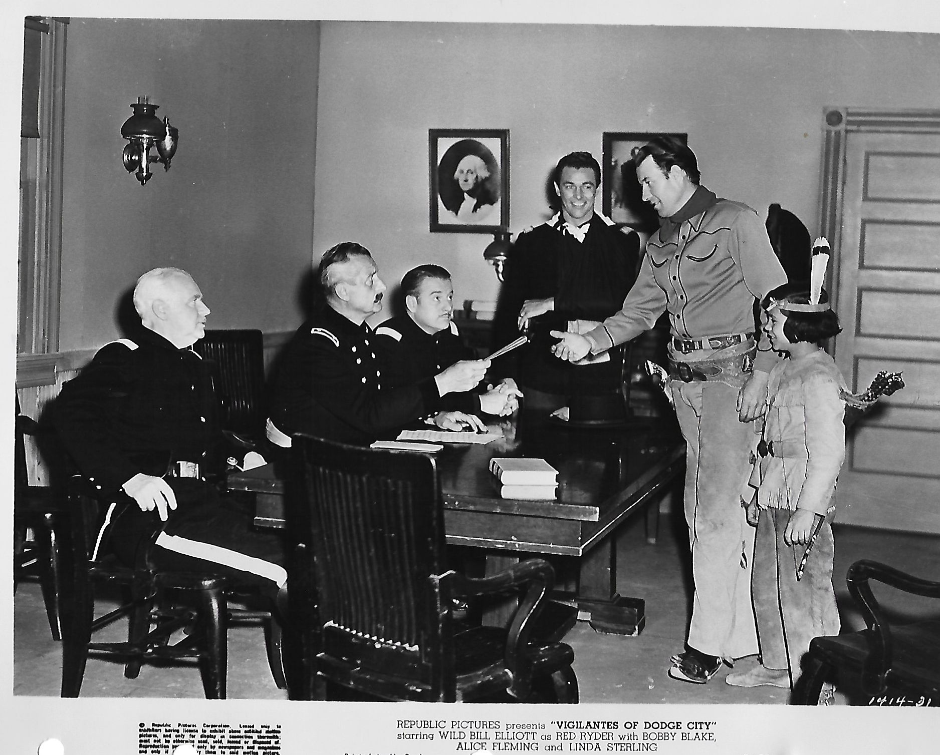 Stanley Andrews, Steve Barclay, Robert Blake, and Bill Elliott in Vigilantes of Dodge City (1944)