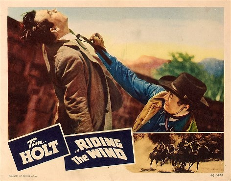 Eddie Dew and Tim Holt in Riding the Wind (1942)