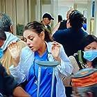 Mila Kunis and Rodney Roldan in The Angriest Man in Brooklyn (2014)