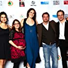 """The cast and crew of """"Chenmo de pengyou"""" on the red carpet of the Beverly Hills Playhouse Film Festival."""