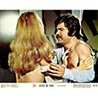 Susanne Benton and Floyd Mutrux in Cover Me Babe (1970)