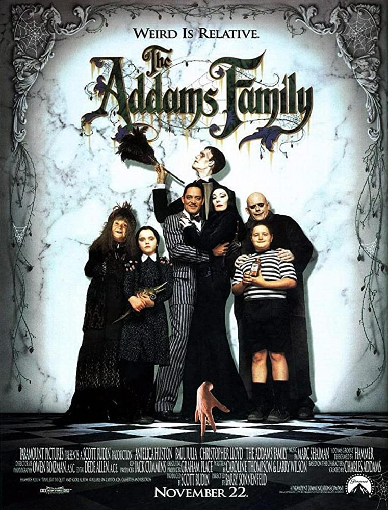 Christina Ricci, Raul Julia, Christopher Lloyd, Anjelica Huston, Judith Malina, Carel Struycken, and Jimmy Workman in The Addams Family (1991)