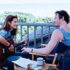 Liam Neeson and Justine Bateman in Satisfaction (1988)