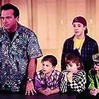 Rachael Leigh Cook, Tom Arnold, and Micah Gardener in Carpool (1996)