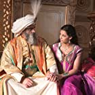 Navid Negahban and Naomi Scott in Aladdin (2019)
