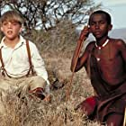 Corey Carrier and Isaac Senteu Supeyo in The Young Indiana Jones Chronicles (1992)