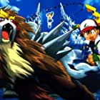 At left, ENTEI; MOLLY (in the background surrounded by UNOWN) with ASH and PIKACHU at right