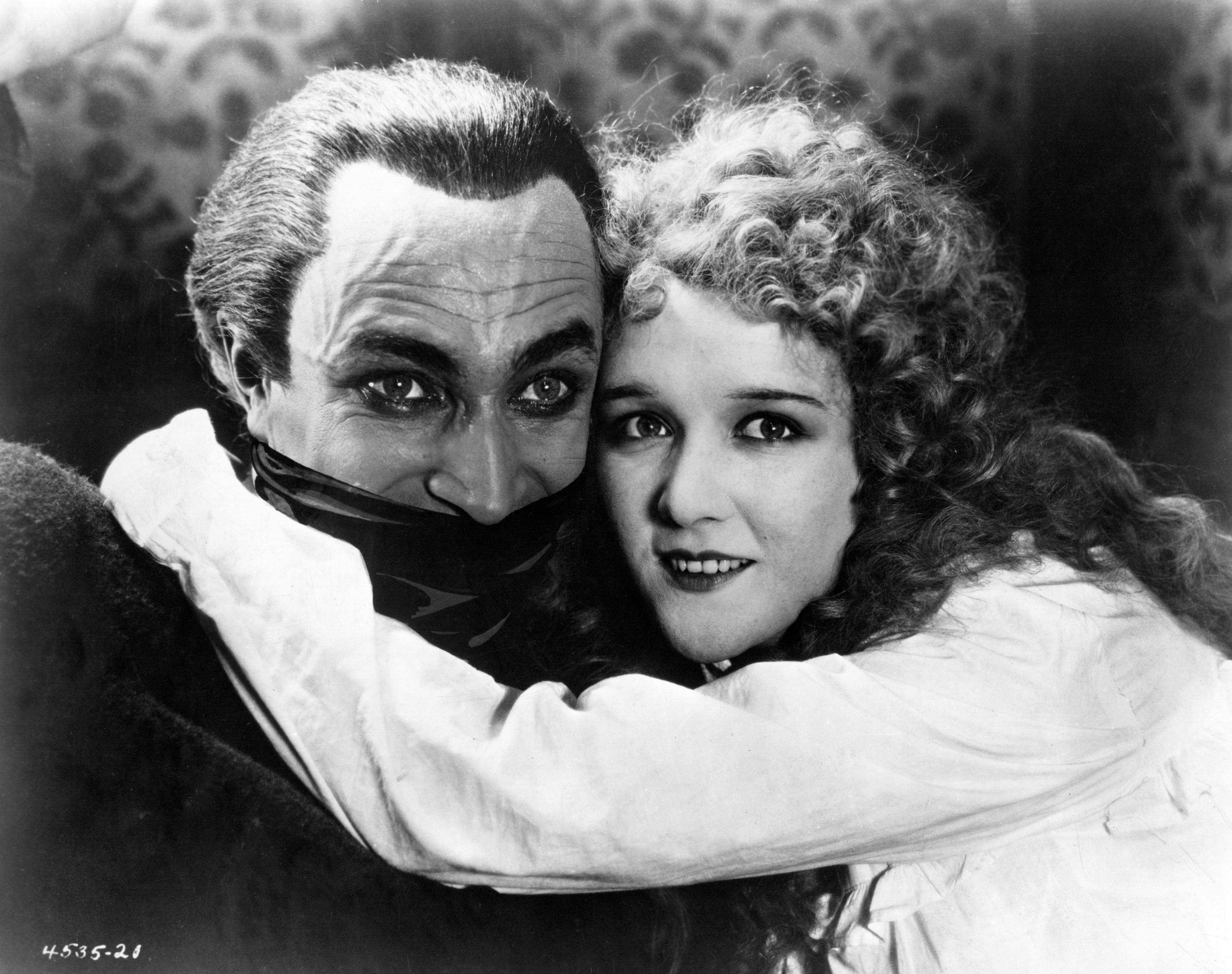 Mary Philbin and Conrad Veidt in The Man Who Laughs (1928)