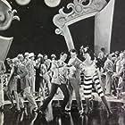 Robert Alda, Glenn Anders, Caroline Burke, Ruth Clifford, Paul Cristo, Oliver Cross, Jay Eaton, Adolph Faylauer, Bess Flowers, Joan Leslie, Leota Lorraine, Wilbur Mack, Ralph McColm, Constance Purdy, Cosmo Sardo, Joan Winfield, and Mary Rosetti in Rhapsody in Blue (1945)
