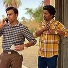 Chandan Roy and Jitendra Kumar in Panchayat (2020)