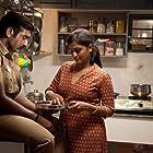 Ramya Nambeeshan and Vijay Sethupathi in Sethupathi (2016)