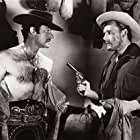 Myron Healey and Gilbert Roland in Apache War Smoke (1952)