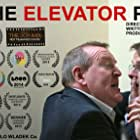 Nigel Betts and Ronan Raftery in The Elevator Pitch (2014)
