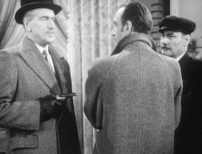 Basil Rathbone, Harry Cording, and Frederick Worlock in Dressed to Kill (1946)