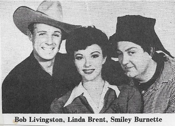 Linda Brent, Smiley Burnette, and Robert Livingston in The Laramie Trail (1944)