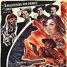 Ray Corrigan, Gwen Gaze, John 'Dusty' King, and Elmer in Underground Rustlers (1941)