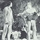 Bruce Bennett, Noble Johnson, Tuffy, and Harley Wood in Hawk of the Wilderness (1938)