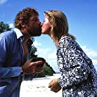Amanda Donohoe and Oliver Reed in Castaway (1986)