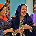 Parminder Gill, Gurpreet Bhangu, and Rakhi Hundal in Muklawa (2019)