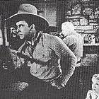 Howard Hickman, George O'Brien, Virginia Vale, and Slim Whitaker in Bullet Code (1940)